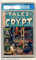 Golden Age (1938-1955):Horror, Tales From the Crypt #27 (EC, 1951). A fabulous Wally Woodguillotine cover highlights this high-grade treasure. Anear-perf...