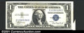 Error Notes:Attached Tabs, 1935A $1 Silver Certificate, Fr-1608, AU. There is a minor atta...