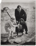 Baseball Collectibles:Photos, 1932 Babe Ruth Oversized Culver Service Photograph. Simply charmingsandlot shot finds the Babe operating as an umpire behin...
