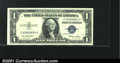 Error Notes:Skewed Reverse Printing, Fr. 1614 $1 1935E Silver Certificate. Gem Crisp Uncirculated....