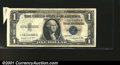 Error Notes:Attached Tabs, Fr. 1616* $1 1935G Silver Certificate. Extremely Fine. A sm...