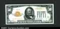Small Size:Gold Certificates, Fr. 2404 $50 1928 Gold Certificate. About Uncirculated.