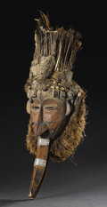 African: , Mau (Côte d'Ivoire). Beaked Power Mask. Wood, metal, nails, amuletpacks, glass, raffia cloth, cowry shells, feathers, porcu...