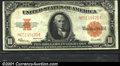 Large Size Gold Certificates:Large Size, 1922 $10 Gold Certificate, Fr-1173, VF-XF. The orange-gold reve...