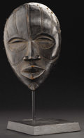 African: , Dan (Liberia). Face Mask. Wood, pigment, nails, string. Height: 9 ¼inches Width: 6 inches Depth: 4 inches. Unusually el...