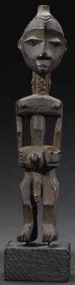 Lulua (Democratic Republic of Congo) Standing figure Wood, patination Height: 5 3/4inches Width: 1 3/8 inches Depth: 1...
