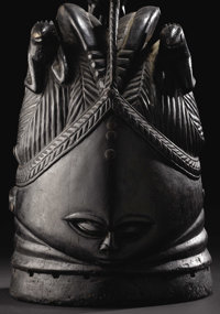 Mende (Sierra Leone) Sowei Helmet Mask Wood, brass tacks Height: 15 ¼ inches Width: 8 ½ inches Depth: 9 in...