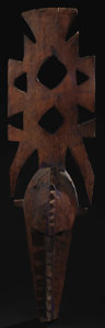 African: , Bobo (Burkina Faso). Nweka Mask. Wood, pigment. Height: 54 ½inches Width: 15 inches. This tall vertical mask has a l...