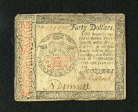 Continental Currency January 14, 1779 $40 Fine. This bright note for the grade has a few small edge splits and a light s...