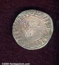 1652 Oak Tree Shilling XF 40 Bent, Cleaned. IN at Bottom. Breen-18. 4.24 grams. The centers are untoned and unnaturally...