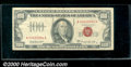 1966-A $100 Legal Tender Note, Fr-1551, Fine-VF. This example is crisp, but has a heavy vertical center crease and a tel...