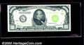 1934 $1,000 Federal Reserve Note (Chicago), Fr-2211-G, XF-AU. This crispy example has a heavy vertical center fold and a...