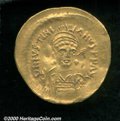 Byzantine, Justinian I 527-565 AD gold solidus, Helmeted and cuirassed bust facing, holding globus cruciger/Angel standi...