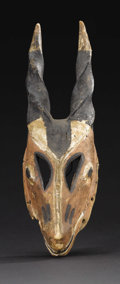 African: , Ogoni (Nigeria). Mask. Wood, pigment,fiber. Height: 16 inches Width: 4 ½ inches Depth: 3 1/8 inches. This is an antelope...