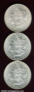 1900-O/CC $1 MS 62, a few heavy abrasions limit the grade; and (2) 1900-O/CC MS 61, both brilliant, lustrous, and modera...