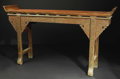 Furniture : Continental, A Chinese Carved and Painted Wood Altar Table. Unknown maker,Chinese. Nineteenth century. Carved, painted and gilded wood...