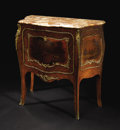 Furniture: French, A Louis XV Style Petit Commode. Unknown maker, French. NineteenthCentury. Various woods, bronze mounts, marble. 35 inches...