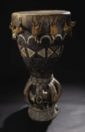 African: , Baga (Guinea). Drum (timba). Weed, pigment, hide, fiber. Height: 46 1/2 inches Dia. (at head): 22 inches. Although th...