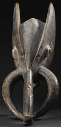 African: , Bamileke? (Cameroon). Elephant Mask. Wood, pigment. Height: 8inches Length: 31 inches Width: 10 ½ inches. This simplifi...