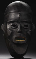 African: , Keaka (Cameroon), Cross River Region. Semi-helmet Mask. Wood, skin. Height: 17 ½ inches Width: 10 ½ inches Depth: 9 inches...