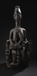 African: , Yoruba (Nigeria). Shrine Group: a Woman Nursing a Child, with NineAttendants. Wood, iron, pigment. Height: 45 inches Width...