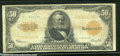 Large Size Gold Certificates:Large Size, 1922 $50 Gold Certificate, Fr-1200, VG-Fine. Several larger pin...
