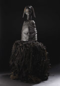 African: , Mende (Sierra Leone). Sowei Helmet Mask. Wood, raffia.Height:of helmet: 22 ½ inches Dia.:16 inches. This stately hel...