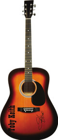 Music Memorabilia:Autographs and Signed Items, Toby Keith Signed Guitar. A orange-sunburst finish Laurel AD100acoustic guitar with a Toby Keith logo and autograph in blac...(Total: 1 Item)