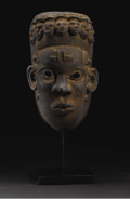 African: , Igbo (Nigeria). mask. Wood, traces of pigment, smoky patina.Height: 12 inches Width: 7 ½ Depth: 6 inches. A sensitive, ...