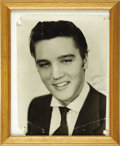 "Music Memorabilia:Autographs and Signed Items, Elvis Presley Autographed Photo. A framed b&w 8"" x 10"" photo ofa young Elvis, inscribed ""Lovingly"" and signed by Presley in...(Total: 1 Item)"