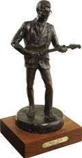 "Music Memorabilia:Memorabilia, Buddy Holly Bronze Statuette. A 12"" bronze statuette of Holly on a6.5"" x 1.75"" x 5.75"" wooden base, #8 in a limited edition...(Total: 1 Item)"