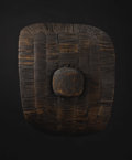 African: , Uganda (?). Shield. Wood, rattan, nail. Height: 18 5/8 inchesWidth: 22 ½ inches. A large number of Bantu peoples, who li...