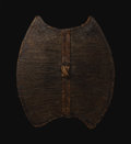 African: , Mfumte / Mambila (Cameroon). Shield. Basketry, wood. Height: 29 inch Width: 26 ¾ inches Diameter: 3 inches. Lacking very...