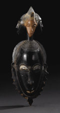 African: , Yaure (?) (Côte d'Ivoire). Portrait Mask. Wood, pigment. Height: 15inches Width: 5 5/8 inches Depth: 4 ¼ inches. A num...