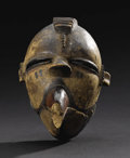 African: , Ogoni (Nigeria). Bird Mask. Wood, pigment. Height: 9 inches Width:5 inches Depth: 5 ¼ inches. This bird mask, with a po...