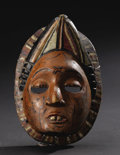 African: , Anang Ibibio (Nigeria), Ikot Ekpene. Mask. Wood, pigment. Height: 9 ½ inches Width: 6 5/8 inches Depth: 4 inches. With a...
