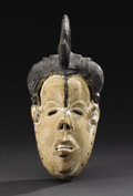 African: , Igbo (Nigeria), Isuama area. Okoroshi Mask. Wood, pigment. Height: 10 ½ inches Width: 4 ¾ inches Depth: 4 ¾ inches. ...