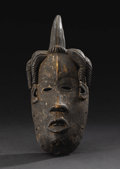 African: , Igbo (Nigeria), Isuama Region. Okoroshi Mask. Wood, pigment.Height: 10 ¾ inches Width: 4 7/8 inches Depth: 3 3/8 inch...