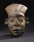 African: , A Grasslands Kingdom (Cameroon). Helmet Mask. Wood, pigment, cloth.Height: 19 ½ inches Width: 12 ¾ inches Depth: 11 5/8 i...