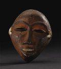 African: , Pende (Democratic Republic of Congo). Face Mask (Mbuya).Wood, pigment. Height: 7 ¼ inches Width: 5 ¾ inches Depth: 3 3/...