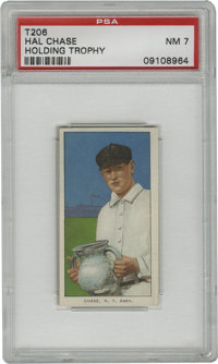 1909-11 T206 Hal Chase Holding Trophy PSA NM 7. A slight issue with centering may have kept this exceptional T206 featur...