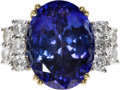 Estate Jewelry:Rings, Tanzanite, Diamond, Gold Ring. The ring centers an oval-shapedtanzanite measuring 14.75 x 11.25 x 8.28 mm and weighing ap...