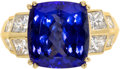 Estate Jewelry:Rings, Tanzanite, Diamond, Gold Ring. The ring centers a cushion-cuttanzanite measuring 11.90 x 11.00 x 7.30 mm and weighing app...