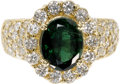 Estate Jewelry:Rings, Tsavorite Garnet, Diamond, Gold Ring. The ring centers an oval-shaped tsavorite garnet measuring 9.65 x 7.75 x 5.15 mm and...