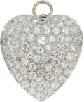 Estate Jewelry:Pendants and Lockets, Diamond, Platinum Pendant-Brooch. The pendant-brooch, designed as aheart, features full-cut diamonds weighing a total of ...