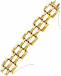 Estate Jewelry:Bracelets, Retro Gold Bracelet. The bracelet has a three dimensional tanktread design crafted in 14k yellow gold, completed by a con...