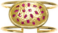 Estate Jewelry:Bracelets, Ruby, Gold Bracelet, Lunia. The bangle features a centralshield-shaped plaque, enhanced by polished rubies of varying sha...