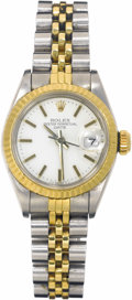 Timepieces:Wristwatch, Rolex Lady's Gold, Stainless Steel Oyster Perpetual Date Wristwatch, circa 1984. Case: 32 x 26 mm, stainless steel with fl...