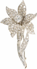 Estate Jewelry:Brooches - Pins, Diamond, White Gold Brooch. The flower brooch features aEuropean-cut diamond weighing approximately 0.70 carat, enhanced...