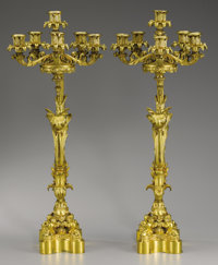 A PAIR OF CONTINENTAL GILT BRONZE CANDELABRA 20th century Marks: SS and S 26-5/8 inche